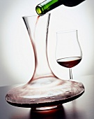 Decanter and glass of Bordeaux red wine