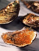 Oysters with salmon egg jelly