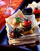 Snail ravioli, vegetable mille-feuille, polenta, subject: amuse-bouche Christmas