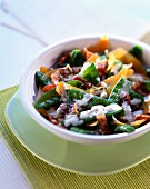 Fricassee stewed sugar peas with bacon and Mimolette cheese