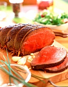 Sliced roast beef on a chopping-board