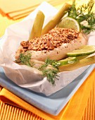Chicken with traditional mustard cooked in wax paper