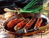 Andouillette chitterling sausages flambed in brandy