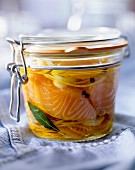 Jar of salmon in oil with potatoes
