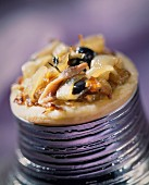 Individual onion and olive tart