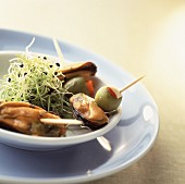 Mussel and olive kebabs