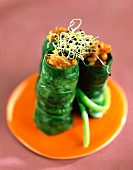 Spinach leaf sushi with salmon and wheat