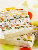 ice cream dessert with pistachio and hazelnut layers (topic : ice creams)