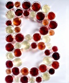 Glasses of red and white wine arranged in letter B shape