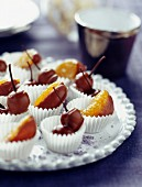 Cherries and clementines dipped in milk chocolate