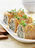 Mini salmon, puy lentil and cress logs