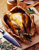 Guinea fowl baked in salt and herb case