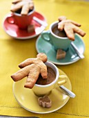 Gingerbread men on cups of coffee
