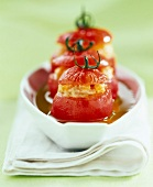 Mini tomatoes baked and stuffed with tuna