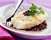 Roast cod with creamed mustard-flavored lentils
