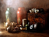 Composition of Chinese teapots with smoke, herbs and tea