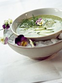 Chilled cucumber and pansy soup