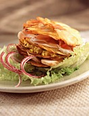 Thin potato pancakes with chicken breast and ham