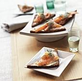 Smoked salmon and creme fraiche on dark bread