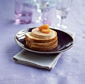 Toasted open sandwiches with foie gras and dried apricots