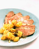 Fillet of duck breast with oven baked potatoes
