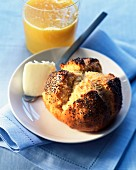 Poppyseed roll and orange juice