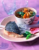 Roast sea bream with garlic and basil vegetables