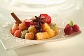 fresh fruit salad with cinnamon and star anise