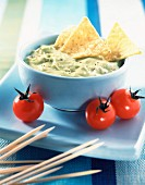 Bowl of Guacamole with cherry tomatoes