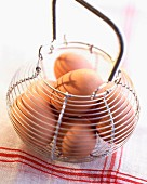Metal basket of eggs