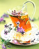 Mug of herbal tea with flowers