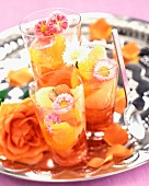 Citrus fruit salad with rose jelly and crystallized daisies