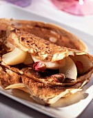 Chestnut flour pancake with pear and rose