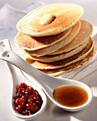 Pancakes with cranberry jam and maple syrup