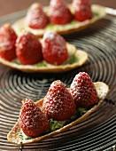 Strawberry and pistachio mini tarts