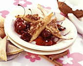 Fried gingerbread triangles with cherries and coconut