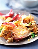 Cod with chicory,potatoes and red onions