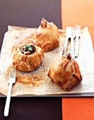 Apples stuffed with duck and blueberries wrapped in puff pastry