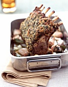 Rack of lamb with herbs and pine nuts