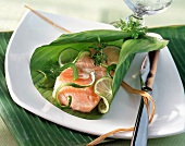 Salmon and lime wrapped in banana leaf