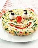 Clown face rice salad