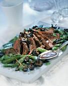 Roast beef with mushrooms and sugar peas