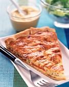 Slice of mustard and tomato tart
