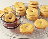 Dipping the choux crowns in the caramel