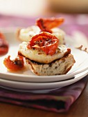 Warm cabecou cheese and dried tomatoes on toast