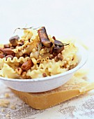 Pasta with mushrooms,dried fruit and parmesan