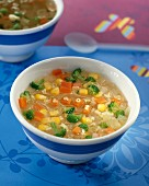 Vegetable soup with alphabet pasta