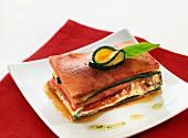 ham, zucchini and tomato lasagna with basil oil