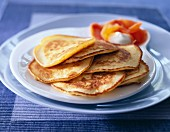 Small thick pancakes with salmon