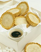 Whiskey tartlets and cup of coffee